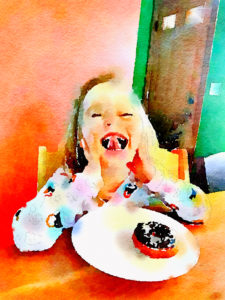 Sarah smiling with a donut